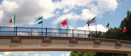 Flag Bridge stock photo, Bridge displaying International Flags of Influence. by JJ Havens