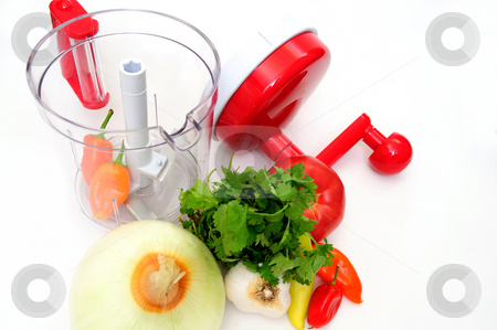 Chili Salsa Maker stock photo, Hand powered food processor with all the ingredientsto make a mexican salsa including oniob, cilantro, garlic, chili and tomato by Lynn Bendickson