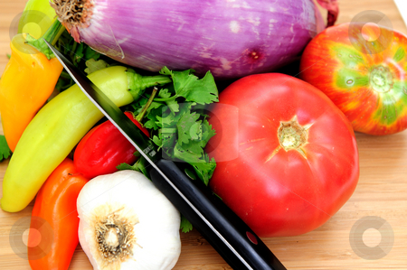 Vegetables For Salsa stock photo, Tomatoes, red onion, garlic, cilantro with red and green chilies on a wooden cutting board ready to cut for fresh salsa. by Lynn Bendickson