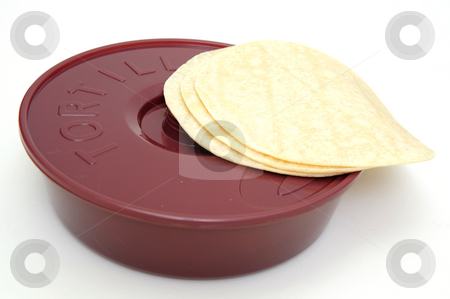 Tortilla Wamer And Tortillas stock photo, Plastic tortilla warmer and three tortillas on a white background. by Lynn Bendickson