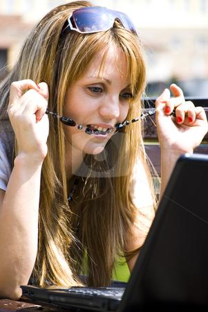 Beautiful young woman with laptop stock photo, Beautiful young woman working out with laptop or notebook by Desislava Dimitrova