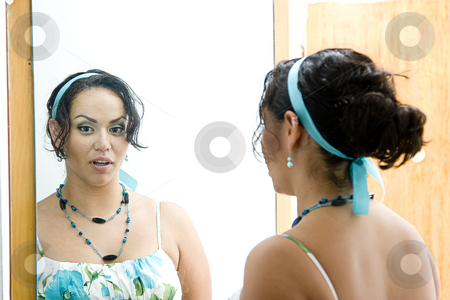 Talking reflection stock photo, Latino women talking to her a reflection in a mirror by Yann Poirier