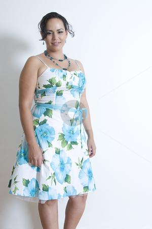Latino fashion model stock photo, Twenty something latino women wearing a dress inspired by the 50's by Yann Poirier