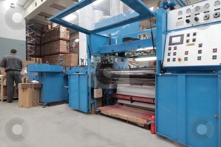 Production stock photo, A Man working in a rotative industrial printer by Bernardo Varela