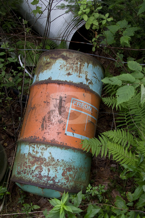 Freon drum stock photo, Old rusted metal drum mark as containing freon gaz by Yann Poirier