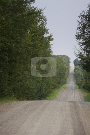Dirt road stock photo, Dirt road passing throught hills by Yann Poirier