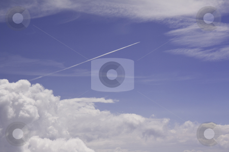 Blue sky, white clouds and jet condensation trail stock photo, Aerial view of blue sky, white clouds and a jet condensation trail by Stephen Goodwin