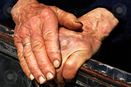 Hard work hands of an old lady stock photo, Old lady's hands showing the signs of hard work by Andreas Karelias