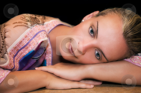 Beautiful woman resting on her arms and thinking stock photo, Portrait of a beautiful young caucasian woman resting on her arms and thinking by Andreas Karelias