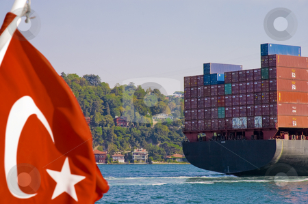 Container shipment. stock photo, Container cargo ship crossing the Golden Horn along Istambul. by Anibal Trejo