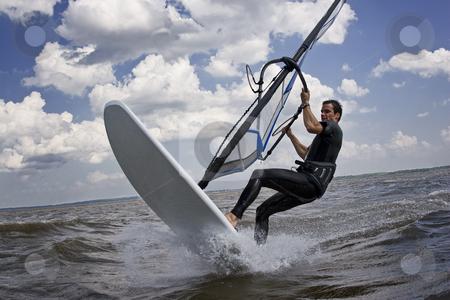 Windsurfer breaking stock photo, Windsurfer doing a breaking trick in the water by Yann Poirier