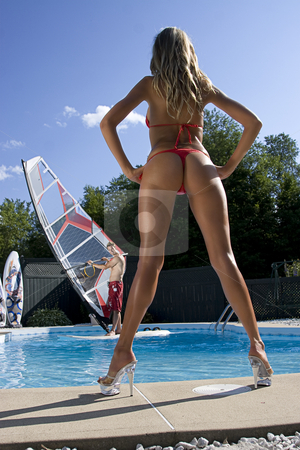 Windsurfer in pool stock photo, Windsurfer in a pool seen throught the legs of a model in a bikini by Yann Poirier