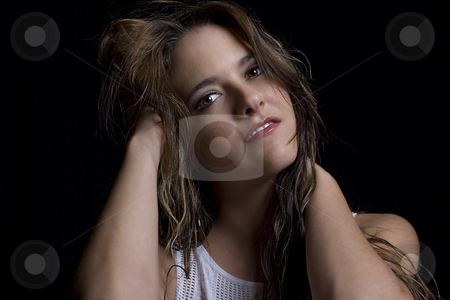 Women in her twenty stock photo, Portait of a women in her twenty with her hand in her hair by Yann Poirier