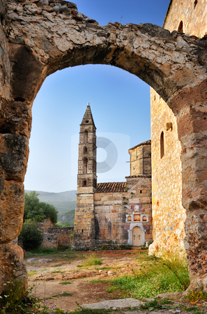 Old church in Kardamili stock photo, Image shows an old historic church in the town of Kardamili, southern Greece, framed by an old arch by Andreas Karelias