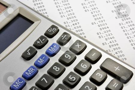 Calculator and financial report stock photo, Electronic calculator on a financial report by Gabriele Mesaglio