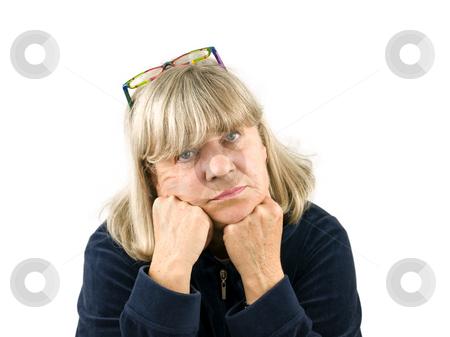 Depressed Senior Woman stock photo, Depressed Senior woman on a white background by John Teeter