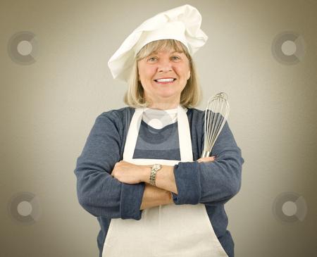 Happy Senior Chef stock photo, Happy Senior Chef on a textured background by John Teeter