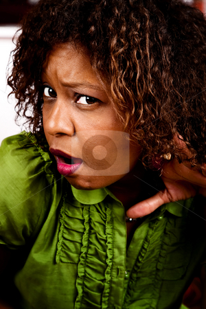 Pretty African American Woman Listening stock photo, Pretty African American Woman in Bright Green Blouse Listening by Scott Griessel