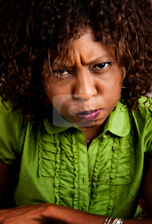 Angry young womn stock photo, Angry young African American woman with stern look by Scott Griessel