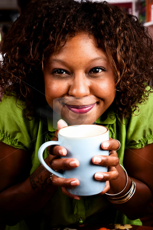 Pretty African American Woman with Coffee stock photo, Pretty African American Woman in Bright Green Blouse with Coffee by Scott Griessel
