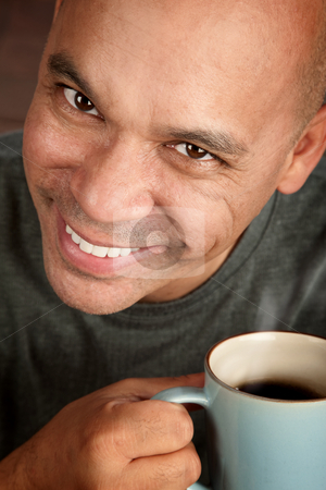 Handsome man with coffee stock photo, Handsome blonde man holding mug of coffee by Scott Griessel