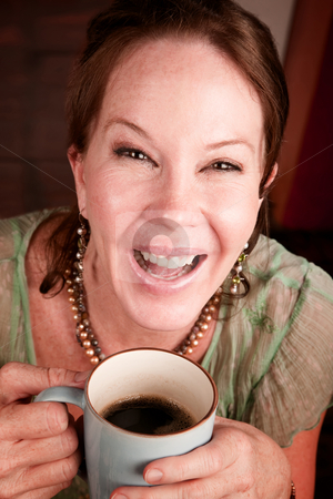 Pretty woman with coffee stock photo, Pretty African American woman with cheerful expression holding coffee by Scott Griessel