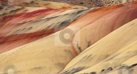 Nature's Palette stock photo, A palette of warm colors and broad brushstrokes found in the beauty of nature among the Painted Hills Monument in Oregon by Mike Dawson