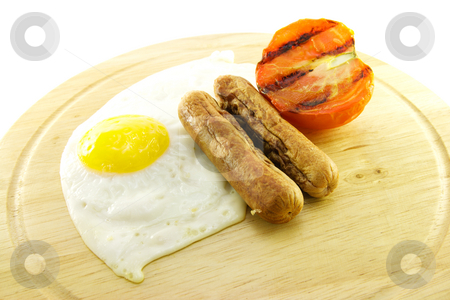 Cooked Breakfast Items on a Plate stock photo, Delicious cooked breakfast items with char-grilled tomato on a plate on a white background by Keith Wilson