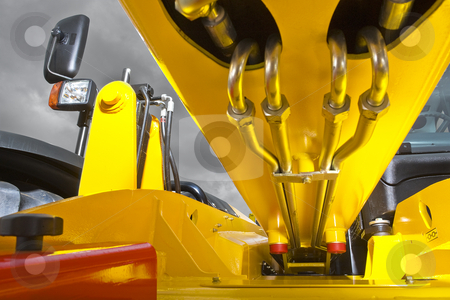 Forklift hydraulics stock photo, The hydraulic wiring of the long arm of a heavy duty loader (forklift) by Corepics VOF