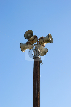 Sirens stock photo, Four sirens on a pole with blue sky in the background. by Denis Radovanovic