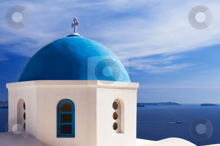 Blue church dome in Santorini, Greece stock photo, A church with a blue dome overlooks the spectacular caldera surrounding the beautiful island of Santorini, Greece by Andreas Karelias