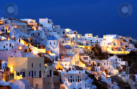 The village of Oia at dusk stock photo, The village of Oia at dusk, on the beautiful island of Santorini, Greece by Andreas Karelias