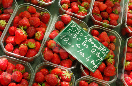 Selling strawberries stock photo, Image shows a strawberry stand in France by Andreas Karelias