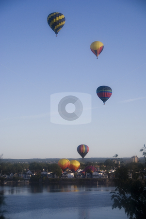 Hot air ballons stock photo, Hot air balloons rising over the City of Gatineau and the Ottawa River in the early morning by June Cairns
