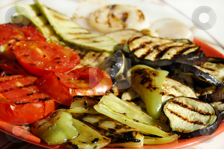 Grilled vegetables stock photo, Grilled paprika, tomatoes and aubergines served on red plate by Julija Sapic