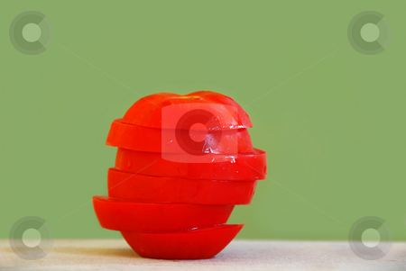 Tomato slices stack stock photo, Red ripe appetizing tomato slices in stack over light green background by Julija Sapic