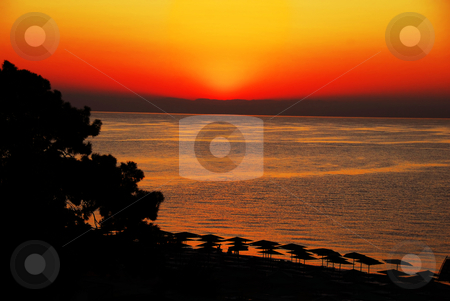 Sunrise over sea stock photo, Moment before sunrise above Mediterranean sea in summer resort in Turkey by Julija Sapic
