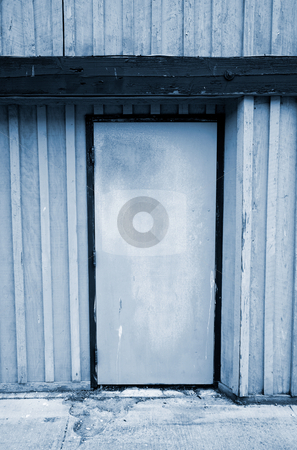 Old Door stock photo, A close up on an an old door on a vacant building. by Travis Manley