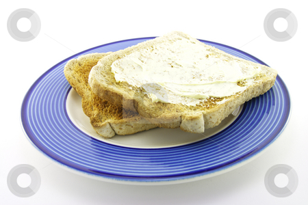 Toast on a Plate stock photo, Slices of lightley browned toast on a blue plate with a white background by Keith Wilson