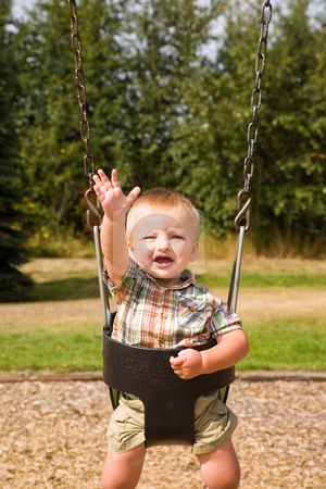 Cute Baby Boy stock photo, A portrait of a cute one year old baby boy on a swing. by Travis Manley