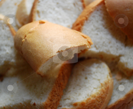 Fresh Slices Of Loaf stock photo, Some fresh slices of loaf with a crisp by Skovoroda