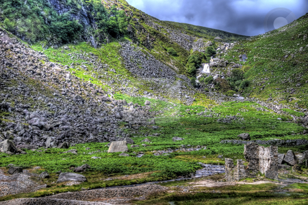 Stone Ruins in Glendalough stock photo, A scence of stone ruins in Glendalough with a waterfall and stream. by Stephen Kiernan