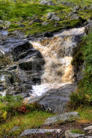 Babbling Waterfall stock photo, A small waterfall flowing downstream. by Stephen Kiernan