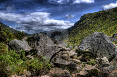 Rocky Terrain In Wicklow stock photo, This is an image of rocky area of Glendalough. Rocks and stones fill u the foreground while the hills of Glendalugh can be seen behind. by Stephen Kiernan