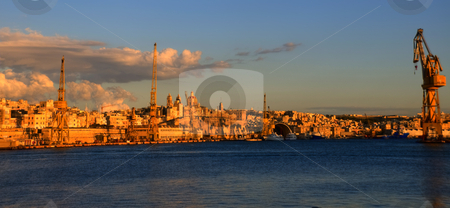 Construction Work on the Shores of Malta stock photo, A landscape view of contruction machines stretching across a shore of Malta. by Stephen Kiernan