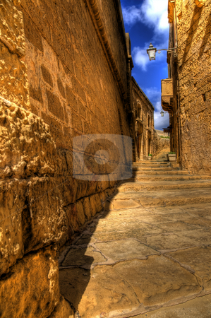 Mdina Pathway in Gozo stock photo, A pathway in the city of Mdina in Gozo. by Stephen Kiernan