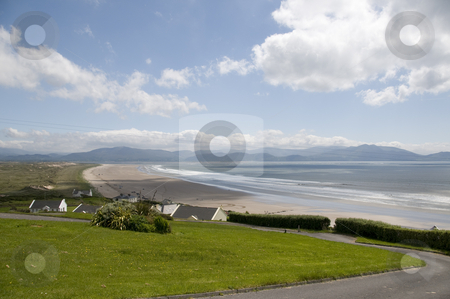 Beach in Co. Kerry stock photo, A beach with clouds in the sky in Co. Kerry in Ireland. by Stephen Kiernan