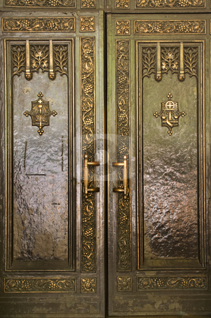 Heavy Brass Door Saint Patrick's Cathedral New York City stock photo, Brass Door Saint Patrick's Cathedral New York City with symbols by William Perry
