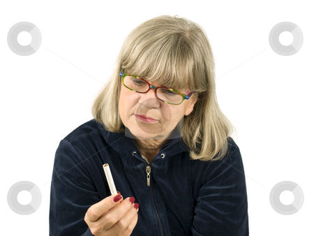 Senior with Cigarette stock photo, Senior Woman Contimplating smoking on white background by John Teeter
