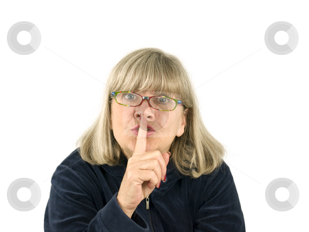 Senior woman with finger to lips stock photo, Senior woman with finger to lips on a white background by John Teeter